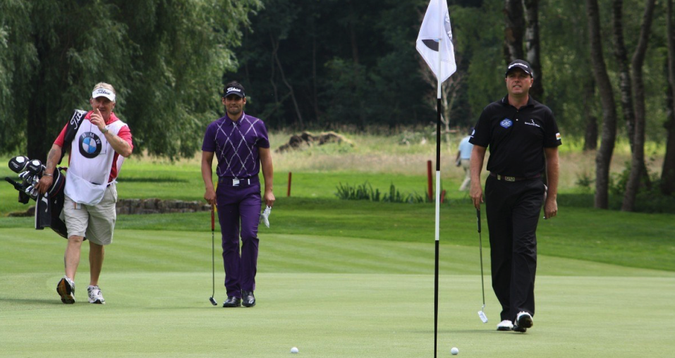 Image showing 3 players walking towards their golf balls near the golf pin flags representing popular golf point game, Bingo Bango Bongo