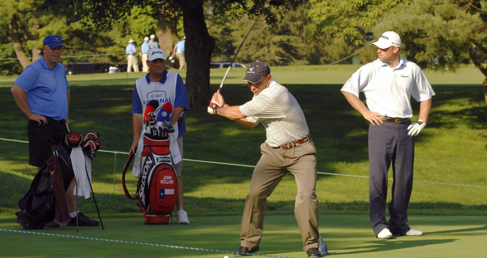 Image showing 4 players where one is playing his shot while others are watching with their golf stand bags representing popular golf point game, Las Vegas