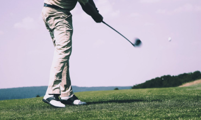 "Blog image: Low angle view of a golfer playing his shot to support the article ""3 fun and exciting golf games to play; Match Play, Round Robin, and Four-ball."